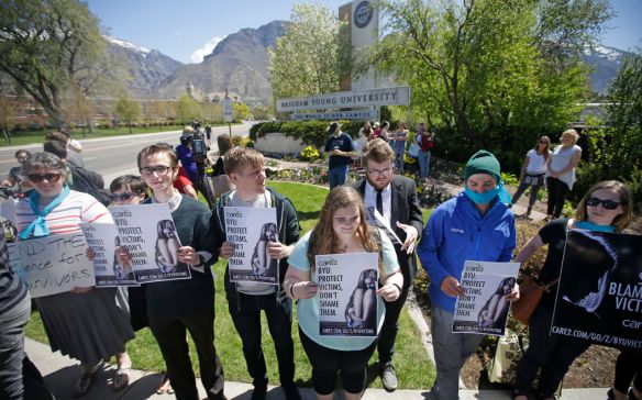 Protesters stand in solidarity with rape victims on the campus of Brigham Young University during a sexual assault awareness demonstration Wednesday, April 20, 2016, in Provo, Utah.